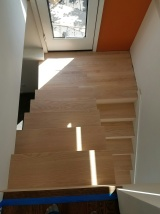 With the custom cut red oak treads and landing